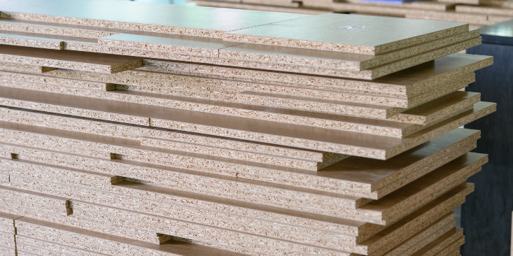 stack of medium density fiberboard pieces for cnc woodworking