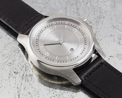 Schon DSGN silver wrist watch with black band