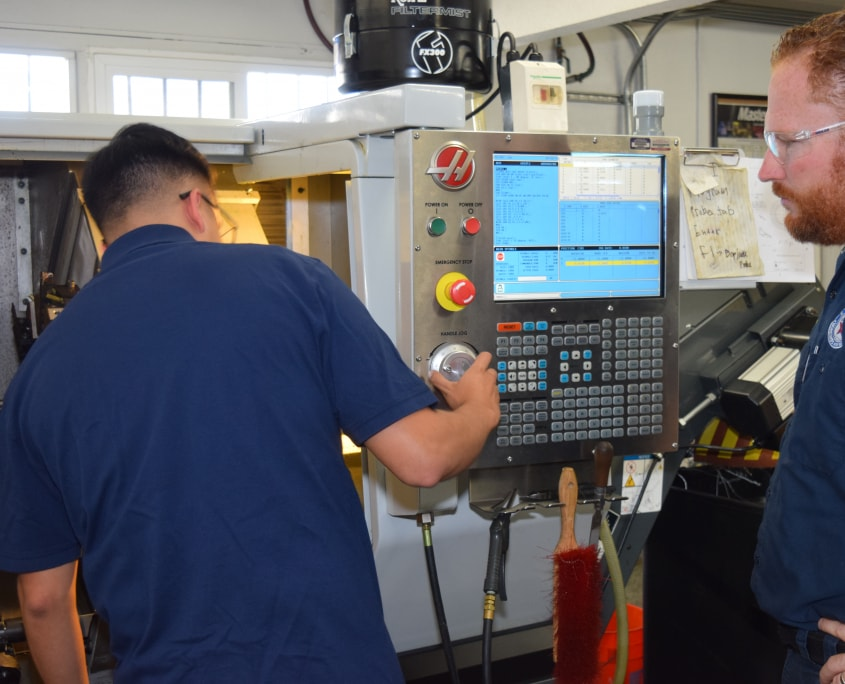 men setting up Haas milling machine